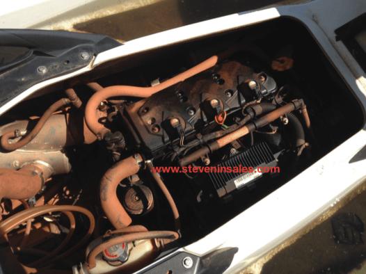 Sunken jet ski engine that is dirty